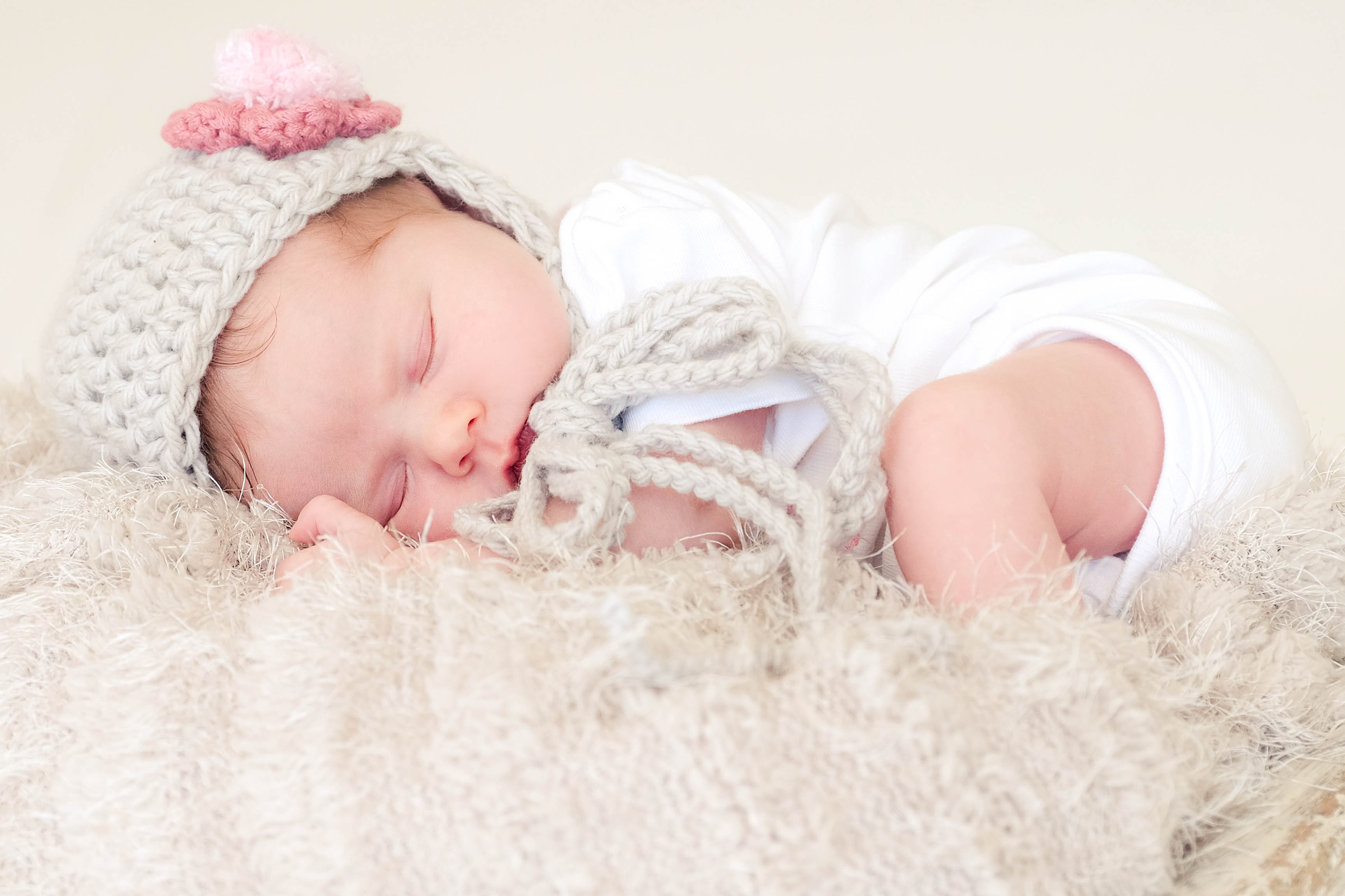 baby sleeping on woollen blanket