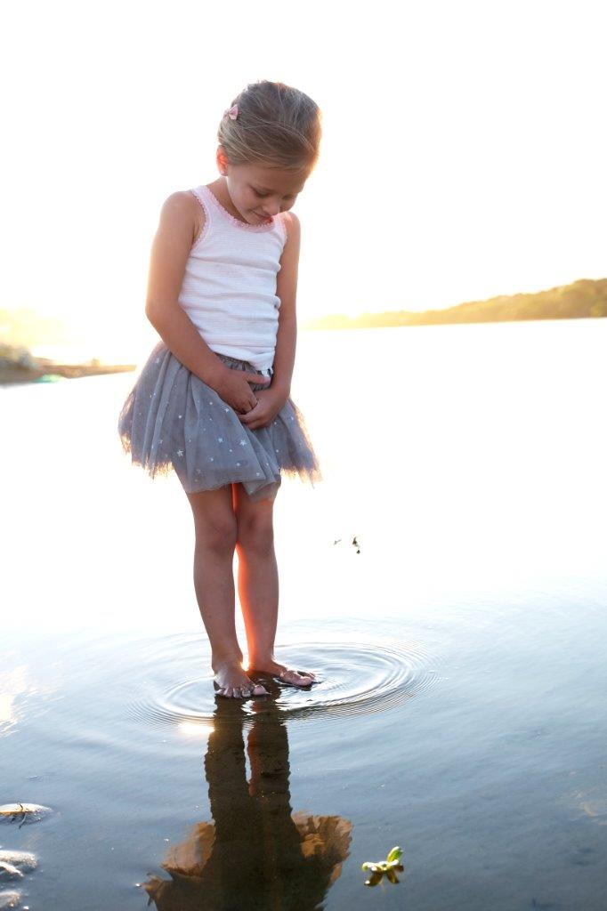 girl standing in a puddle
