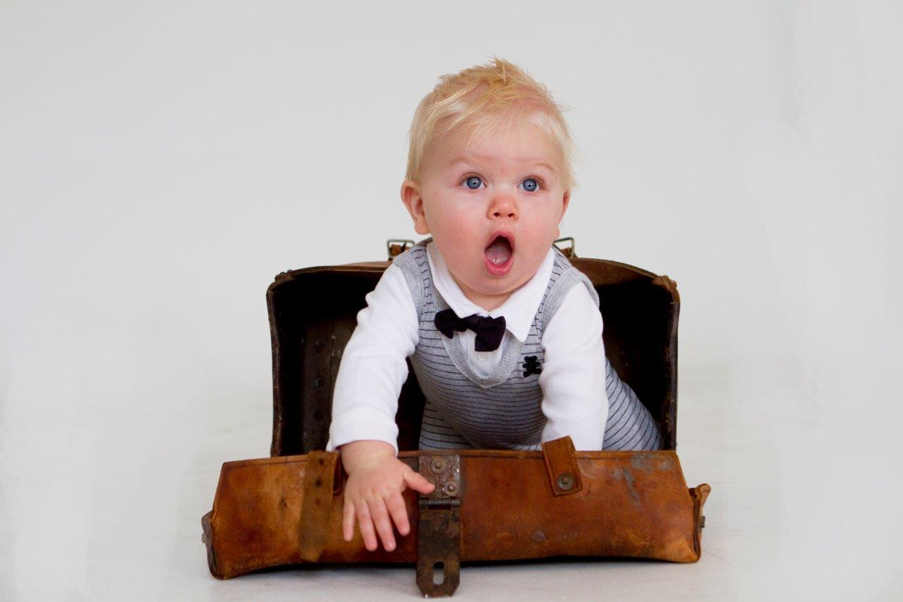 baby boy in an old suitcase