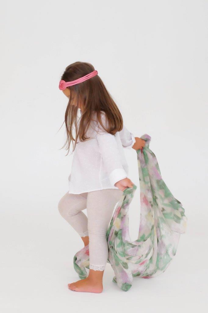 little girl twirling in skirt