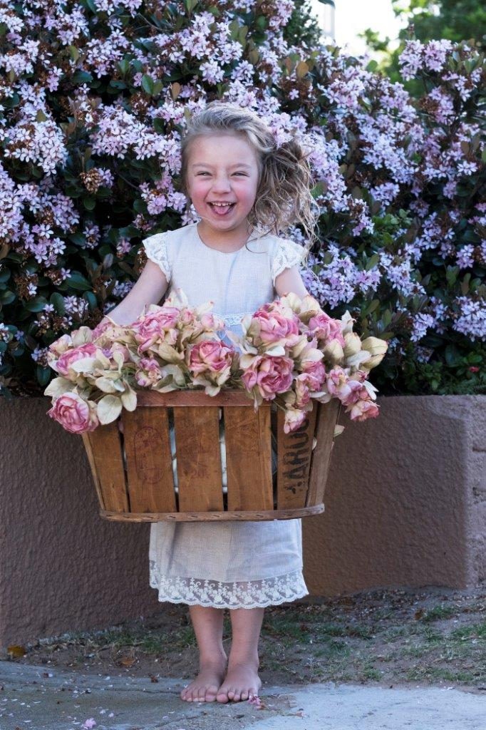 girl holding a basket of flowers