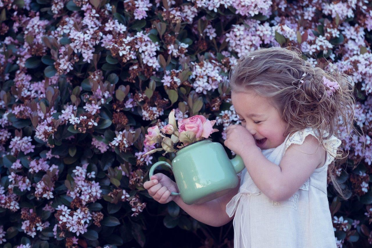 girl laughing with teapot